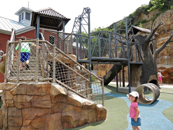 Girl playing on playground at Teddy Bear Park in Stillwater Minnesota